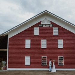 Bride + Groom in front of Barn